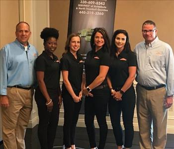 Six members of SERVPRO Marketing wearing corporate logo attire