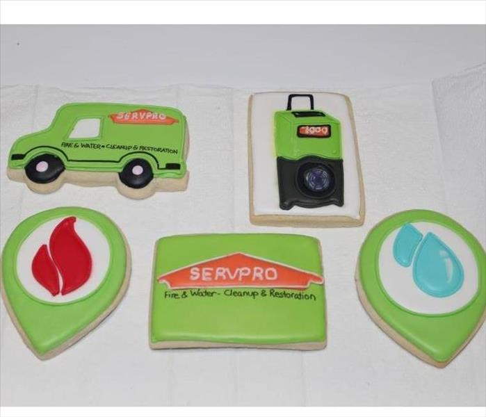 sugar cookies in the design of a dehumidifier, a SERVPRO van, a water drop, a fire logo, and the SERVPRO logo