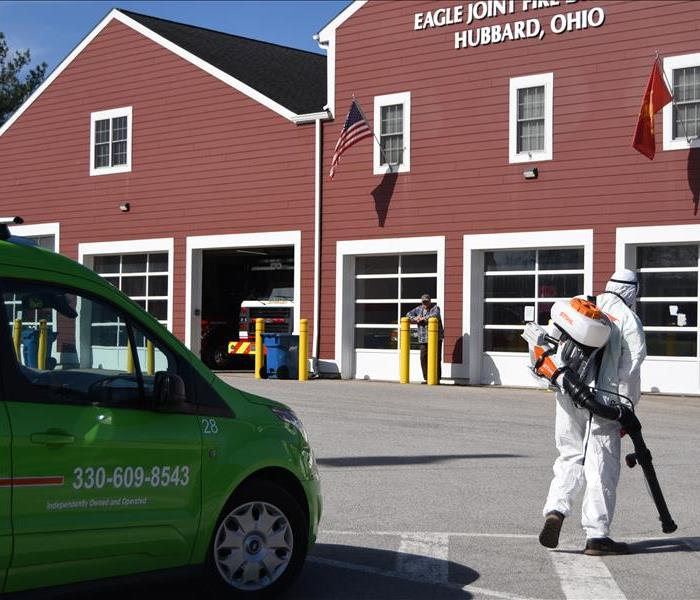 image of Fire Station and SERVPRO worker sanitizing the Fire truck parked