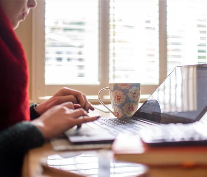 image of female working from home with their laptop open on a table