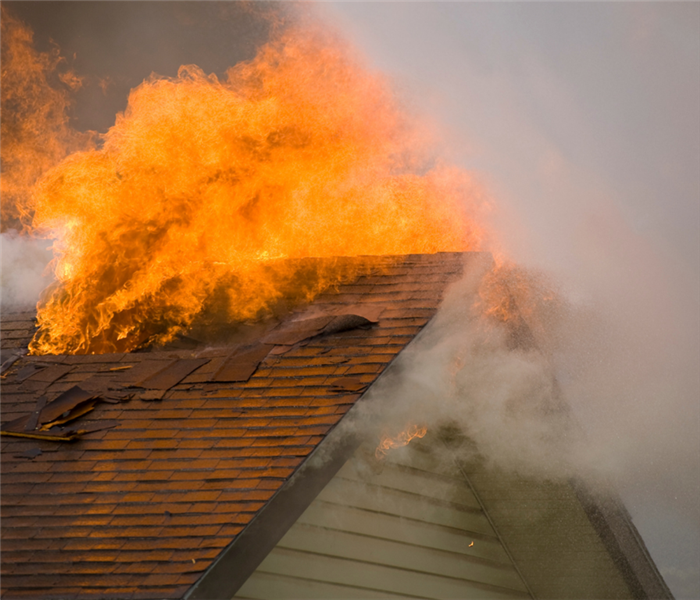 Picture shows a home on fire with a closeup of the roof